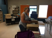 Ms. Loxterkamp unpacking her boxes.