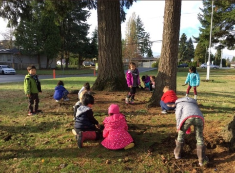 Kinders planting spring bulbs out front.